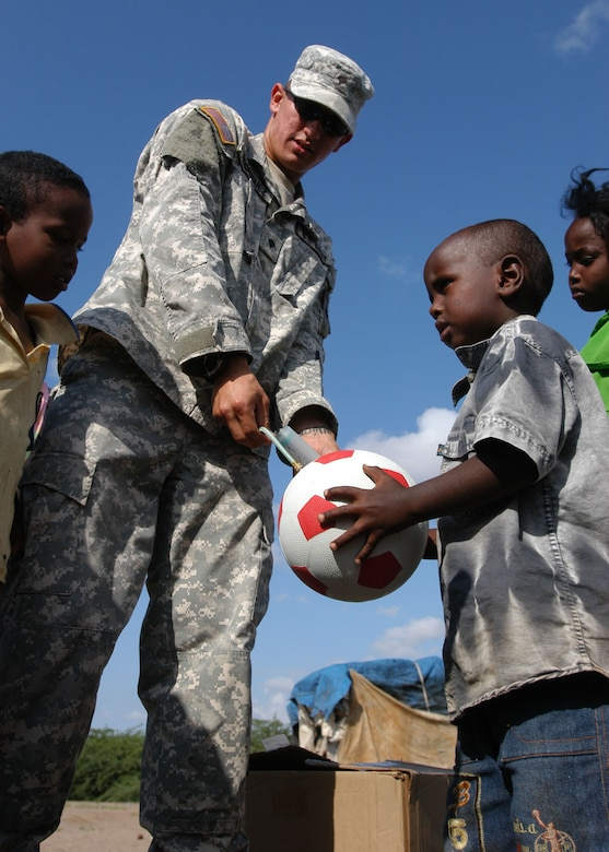 "An Army soldier, deployed to the Horn of Africa, inflates a soccer ball as part of ""Operation Play."" Operation Play is designed to provide school children on the Horn of Africa with soccer balls and is being implemented by former East Carolina University soccer player, Lt. Col. Joe Atkins, 314th Mission Support Squadron commander."