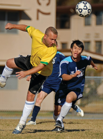 OSAN AIR BASE, Republic of Korea --  Ian Snowsill, 51st Maintenance Group, headbutts the ball as the Osan Mustangs try to move the ball down field to the Cheongju Tigers' goal. The Mustangs, Osan's soccer club, plays in the amateur 'Super Sunday Futbol League.  (Photo by Staff Sgt. Joshua Klahn)