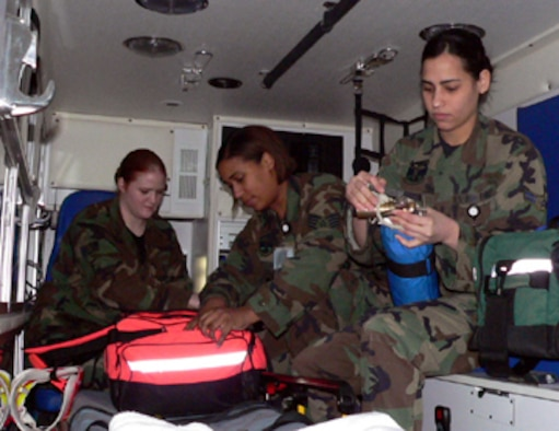 01/29/2007 -- MISAWA AIR BASE, Japan -- Staff Sgt. Melissa Smith (back), Staff Sgt. Trisha Mickles (center), and Airman 1st Class Yara Lebron, 35th Medical Group emergency medical technicians, check their gear in the ambulance. The Medic 1 team responded to a 911 call Jan. 16 at the Misawa Potter Fitness Center.  With the assistance of the base fire department, the first responders were able to resuscitate the victim and medical evacuate him for further treatment. (U.S. Air Force photo by Staff Sgt. A.C. Eggman)