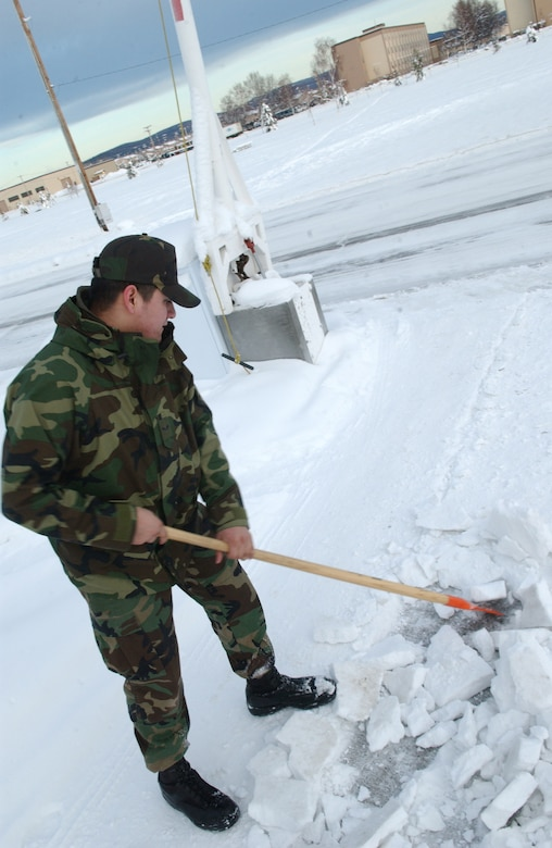 EIELSON AIR FORCE BASE, Alaska -- 354 Civil Engineer Squadron's Airman First Class Catlin Goodrich breaks away frozen ice in front of his Dormitory on Jan 30, 2007. A1C Goodrich is on Bay Orderly this week which consists of keeping the inside and outside of the dormitory in clean and working order, during the winter a lot of the time is spent shoveling snow to make safer paths to walk on. 