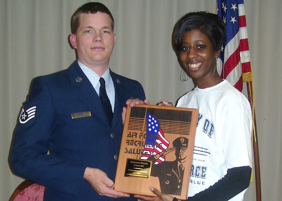 Jacqueline Watkins, Air Force Delayed Entry Program member, and her recruiter Staff Sgt. Robert Lollar, 331st Recruiting Squadron, show the Air Force Recruiting Salutes award the DEPper was awarded Jan. 18 for her demonstration of bravery and compassion by helping to save a man's life Dec. 27. (Enhanced U.S. Air Force photo)