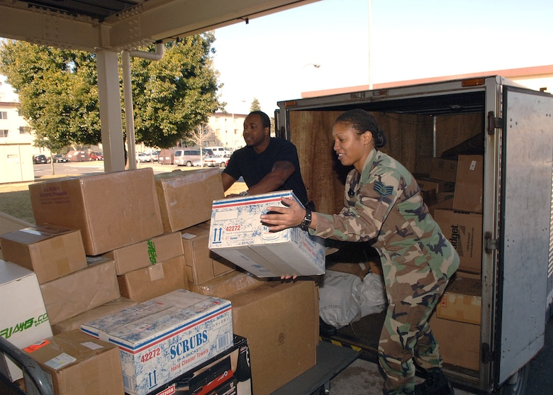 Staff Sergeants Charles Mewallif and Angelina Clayborn unload mail and packages from a delivery truck Jan. 30 at the post office on Yokota Air Base, Japan. Yokota AB receives approximately 5,000 individual letters and 500 parcels daily. The sergeants are assigned to the 374th Communications Squadron. (U.S. Air Force photo/Senior Airman Veronica Pierce)