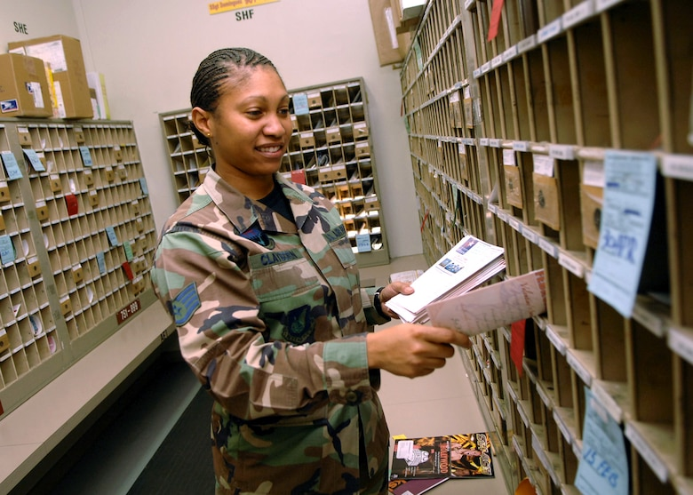 Staff Sgt. Angelina Clayborn places letters into residents mail boxes works Jan. 30 at the post office on Yokota Air Base, Japan. Yokota AB receives approximately 5,000 individual letters and 500 parcels daily. Sergeant Clayborn is assigned to the 374th Communications Squadron. (U.S. Air Force photo/Senior Airman Veronica Pierce)