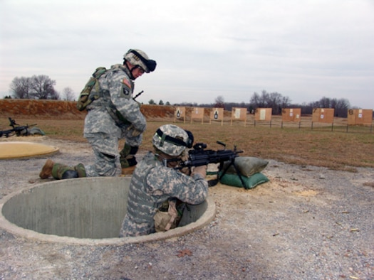A 101st Airborne Division solider fires his squad automatic weapon on the base range. (U.S. Air Force photo)
