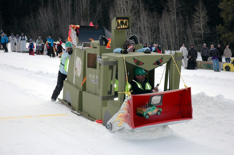 The 25-foot Snow Bull from Schriever AFB plows down the slope Jan. 27 at Keystone. The sled, built by Airmen and civilians from the 50th Civil Engineer Squadron at Schriever, won the Most Creative Design award. (U.S. Air Force photo by Steve Brady)
