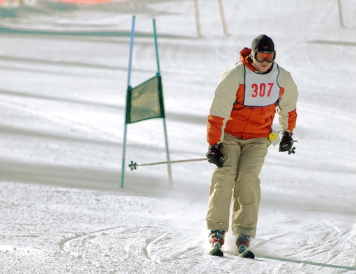 """KEYSTONE, Colo. -- Stan Rogers of Peterson Air Force Base's """"Celestial Cowboys"""" team finishes a National Standard race Jan. 26. The Celestial Cowboys placed second in the NASTAR skiing tournament. (U.S. Air Force photo/Staff Sgt. Amanda Delisle)"""