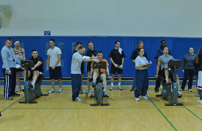 EIELSON AIR FORCE BASE, Alaska--Airmen compete in a stationary bike race during a four-person team competition featuring unique challenges. The 354th Communications Squadron team took the $400 first place prize. More than 400 Airmen and their families attended the X-Treme Winter Challenge hosted by the 354th Services Squadron and BASE 24/7. (U.S. Air Force phot by Senior Airman Justin Weaver)