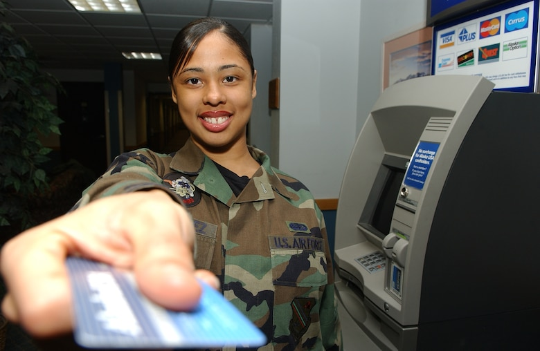 EIELSON AIR FORCE BASE, ALASKA-- Senior Airman (SrA) Johanna Gonzales uses an ATM located in the Gold Rush Inn. The ATM was moved from the BX hallway into the inn so that Airman and their families would have 24-Hour access to the ATM. Senior Airman Gonzales is assigned to the 354th Services Squadron, 354th Mission Support Group, 354th Fighter Wing. (US Air Force photo by Senior Airman Anthony Nelson Jr)