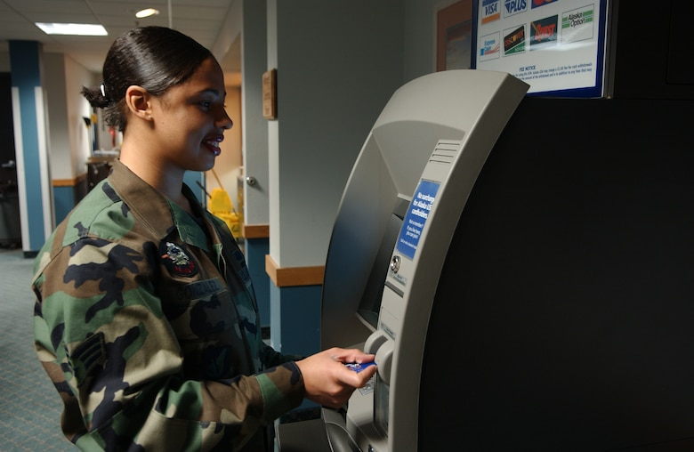 EIELSON AIR FORCE BASE, ALASKA-- Senior Airman (SrA) Johanna Gonzales uses an ATM located in the Gold Rush Inn. The ATM was moved from the BX hallway into the inn so that Airman and their families would have 24-Hour access to the ATM. Senior Airman Gonzales is assigned to the 354th Services Squadron, 354th Mission Support Group, 354th Fighter Wing.