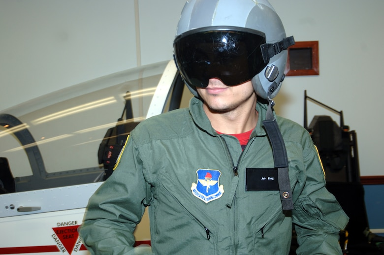 Joe King, The Fray guitarist, sports his flight suit and helmet during T-37 egress training prior to his orientation flight Tuesday at Columbus Air Force Base. Band members received a wing mission briefing and had lunch with CAFB members before their flights. (Photo by Senior Airman John Parie)