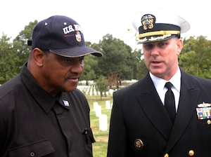 Navy Capt. Christopher W. Grady (right), former commander of the USS Cole, chats with retired Navy Chief Petty Officer Louge Gunn, whose son, Seaman Cherone L. Gunn, was killed in the Oct. 12, 2000, terrorist attack on the Cole. Grady was the keynote speaker during the White House Commission on Remembrance's fifth anniversary tribute to those who died on board the Cole. Photo by Rudi Williams