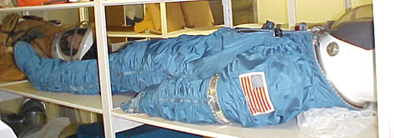 This model MH-7 training suit, produced by United Aircraft's Hamilton Standard Division, was a durable, cost-effective tool for preparing USAF astronauts for Manned Orbiting Laboratory missions in more advanced suits. MOL was to use USAF-modified NASA Gemini spacecraft to put two crewmen in a space station for up to a month. (U.S. Air Force photo)