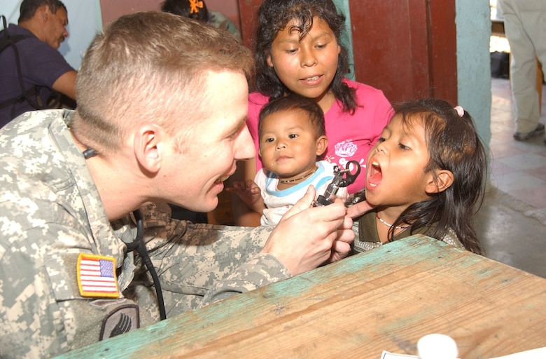 EL HORNO, Honduras - Army Maj. (Dr.) Richard Malish, a cardiologist and the flight surgeon at Soto Cano Air Base, Honduras, examines a child during a Medical Readiness Training Exercise on June 29, 2007.  The medical team saw 1,072 patients during the two-day mission. (U.S. Air Force photo/Tech. Sgt. Sonny Cohrs)