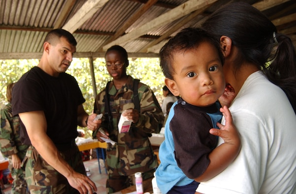 EL HORNO, Honduras - Master Sgt. Alvaro Magana, left, and Staff Sgt. Natasha Johnson, both from the Medical Element at Soto Cano Air Base, Honduras, explain to a mother the recommended dosage for her son while dispensing medication during a Medical Readiness Training Exercise June 29, 2007. (U.S. Air Force photo/Tech. Sgt. Sonny Cohrs)