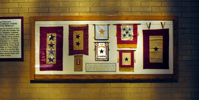 DAYTON, Ohio - These service flags from different eras show how designs have varied. Though they are now commercially made according to standards approved by Congress, many have been home-made with wide variations in symbols, shapes, fringe and lettering. The blue and gold stars remain constant elements. The flags are on display in Kettering Hall at the National Museum of the U.S. Air Force. (U.S. Air Force photo)