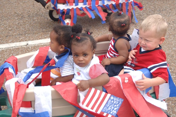Youth at the Child Development Center take part in a parade Tuesday to celebrate Independence Day. Youth made noise makers and carried flags through the parade. Many parents were onsite to watch the children march. (U.S. Air Force Photo by Airman 1st Class Danielle Powell)