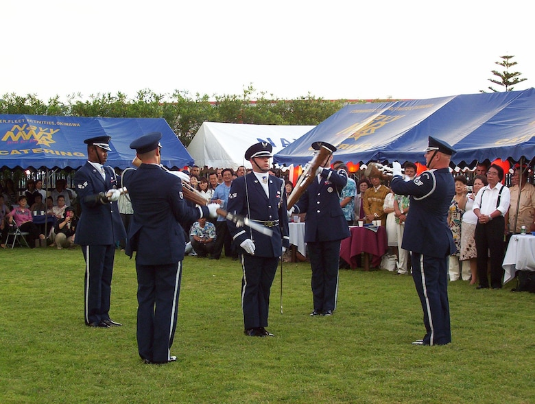 Kadena Air Base Honor Guard Drill Team performs at the 231st United States Independence Day Ceremony and Garden Party at the U.S. Consulate in Naha, Okinawa, Japan, July 4, 2007.  The day was celebrated by more than 200 Okinawans and Americans.  In addition to the drill team, the Marine Corps III MEF Band performance, an Hawaiian Ukulele and Hula dance and a Karate performance was also enjoyed by those in attendance.  (U.S. Air Force photo by Maj. Dani Johnson)