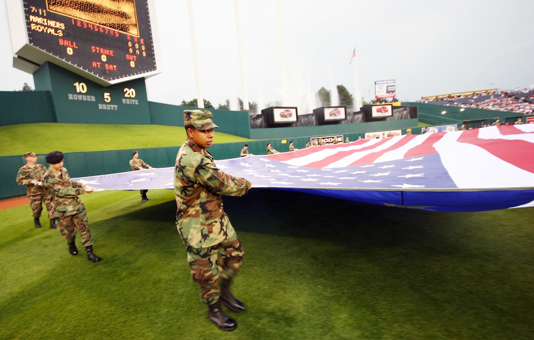 KANSAS CITY, Mo. - More than 30 Team Whiteman members prepare the flag for display during the National Anthem July 4 at Kaufmann Stadium, home of the Kansas City Royals. (U.S. Air Force photo/Tech. Sgt. Matt Summers)