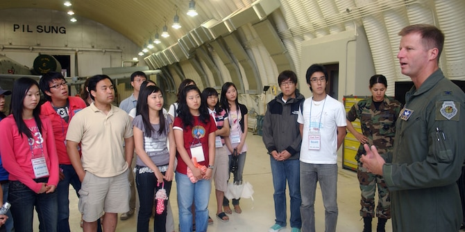 OSAN AB, Republic of Korea – Students from the Far East University in Chungbuk, Republic of Korea, were greeted by Colonel Steven Kempf, 51 Fighter Wing vice commander on July 2, 2007.  The students were touring the base to learn about Osan's mission and personnel, the trip also served as an English language immersion day.  (U.S. Air Force photo by Airman 1st Class Jason Epley)