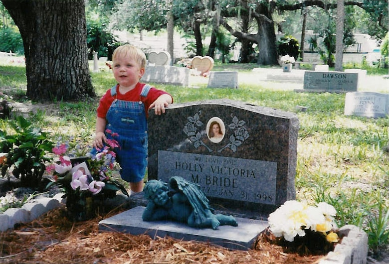 Dakota, Holly McBrides?s 13-month-old son, visits her gravesite at a cemetery in Bonita Springs, Fla., shortly after a drunk driver crashed 