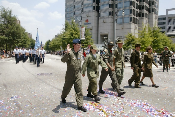 "Personnel from Dobbins Air Reserve Base, Ga. including the 94th Airlift Wing and the 22nd Air Force Headquarters, along with various organizations from Warner Robins Air Force Base, Ga., dressed in period uniforms for the July 4 ""Salute 2 America"" parade in downtown Atlanta. They were followed by members in dress blues, flight suits, and battle dress uniforms, making up three flights representing the Air Force.(U.S. Air Force photo/Don Peek)"