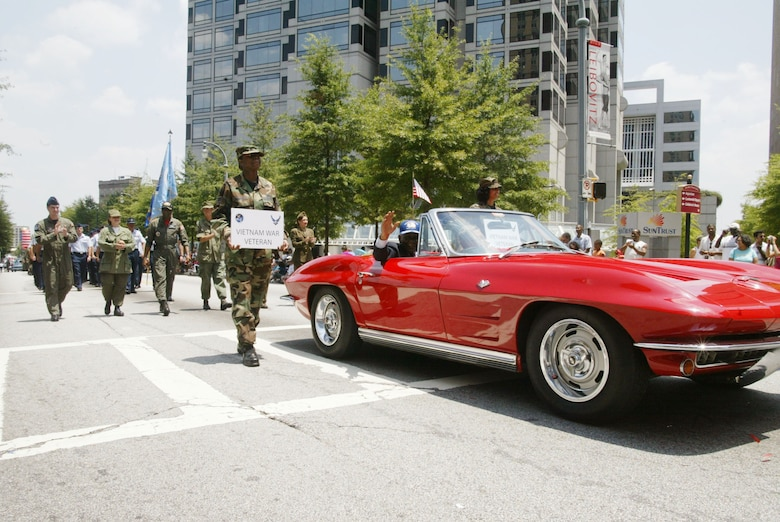 "Chief Master Sgt. Kay Mack, riding in a 1964 Chevrolet Corvette and in his original uniform, represents the Vietnam Veterans of Georgia at the ""Salute to America"" parade in downtown Atlanta on the 4th of July.(U.S. Air Force photo/Don Peek)"
