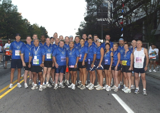 A contingent of Air Force members and volunteers from Dobbins Air Reserve Base, Ga., ran representing the Air Force in the annual Peachtree Road Race in downtown Atlanta July 4th. The event draws more than 75,000 applicants, 55,000 of whom are chosen to run. (U.S. Air Force photo/Don Peek)