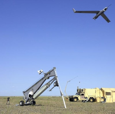 A Scan Eagle Unmanned Aerial System launches from a catapult. (U.S. Air Force photo)