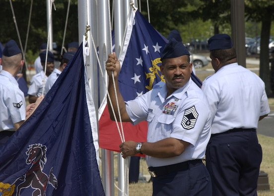 Chief Master Sgt. Sidney McNeil, 11th Civil Engineer Squadron, waits for the signal to raise his flag during a ceremony July 9 as part of the Arnold Gate dedication ceremony at Bolling. Re-establishing Bolling's Avenue of Flags, the ceremony involved the simultaneous rising of 56 different flags by members of the Bolling community representing the 50 states, as well the District of Columbia, Guam, Puerto Rico, American Samoa, Northern Marianna Islands and the U.S. Virgin Islands. (U.S. Air Force photo by Airman 1st Class Sean Adams)