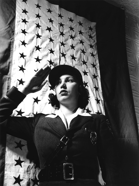 The Bendix Aviation plant, Brooklyn, New York, showed its pride in its employee service members with this very large service flag during World War II. A plant guard salutes in this March 1943 photo. (U.S. Air Force photo)