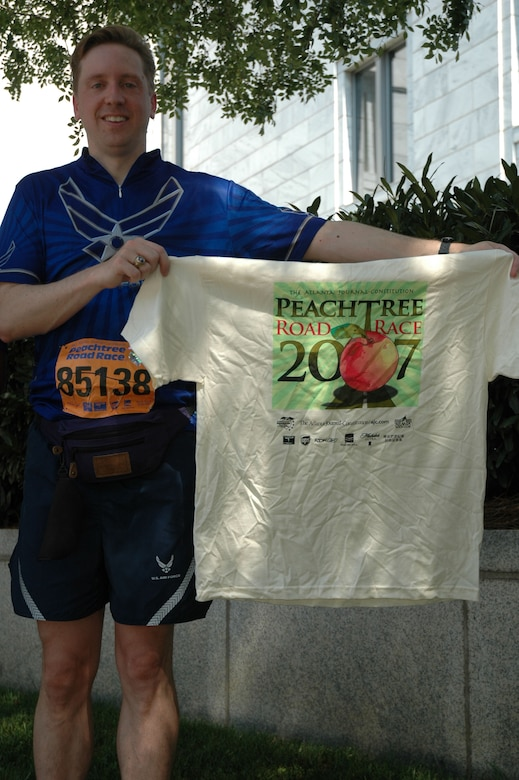 Maj. Mark Jordan, 94th Operations Group, Dobbins Air Reserve Base, Ga., proudly holds his Peachtree Road Race T-shirt after completing the annual July 4 run in downtown Atlanta. The shirts are a status symbol among runners, not only in the Southeast, but around the world.