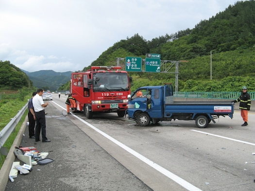 NEAR GWANGJU, Republic of Korea -- Korean emergency responders clean up the scene of this accident after a blue pickup truck (pictured here) was involved in an accident with an 18-wheeler semi truck. Two Airmen, Capt. Thomas Filosi and Staff Sgt. Andrew Quinn, responded to the accident, performing Self Aid Buddy Care to the driver of the pickup, who was thrown through the windshield. Both Airmen are assigned to the 8th Maintenance Squadron at Kunsan Air Base, Republic of Korea. (U.S. Air Force photo/Capt. Thomas Filosi)