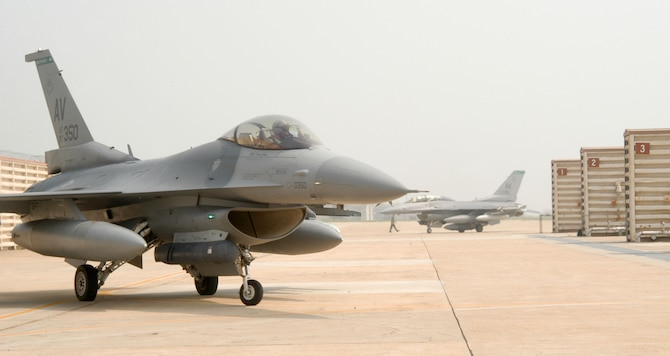 """KUNSAN AIR BASE, Republic of Korea -- Pilots from the 555th Expeditionary Fighter Squadron """"Triple Nickel"""" guide their F-16 Fighting Falcons in to Kunsan's Panton pad July 7 after arriving from Alaska. More than 10 aircraft assigned to 555th EFS arrived here from """"The Last Frontier"""" state after being hampered by poor weather conditions. The Triple Nickel is deployed to Kunsan as part of a force posture adjustment in the Northeast Asia region. (U.S. Air Force photo/Senior Airman Stephen Collier)"""
