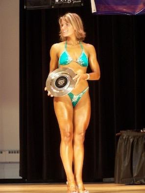 Crys'Dawna Gisselberg, 509th Security Forces Squadron, holds a silver plate representing 5th place during the award presentations at the Natural Tulsa Bodybuilding, Figure and Fitness Championships in Tulsa, Okla., June 23. It was Mrs. Gisselberg's first bodybuilding competition. (Photo printed with permission of Crys'Dawna Gisselberg)