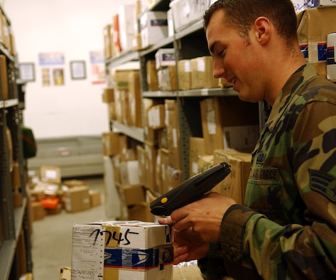 OSAN AIR BASE, Republic of Korea -- Senior Airman Bradley Williams of the 51st Communications Squadron postal flight uses the post office's new A2B tracking system to process mail.  The system was put into use on July 1st, making Osan the first base in PACAF to implement the new process.   (U.S. Air Force photo by Staff Sgt. Christopher A. Marasky)