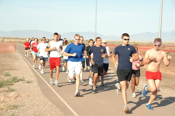 Members of the 49th Fighter Wing participate in a fun run July 3 as part of the Freedom Fest Independence Day celebration. (U.S. Air Force photo by Airman 1st Class Jamal Sutter)