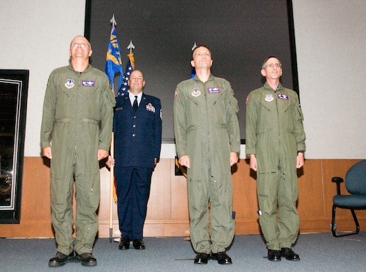 From left: Col. Arnie Bunch, 412th Test Wing commander, Master Sgt. Michael Brown, 412th Operations Support Squadron tower chief, Col. Terry Luallen and Col. Andre Gerner stand at attention during the U.S. Air Force Test Pilot School change of command ceremony at the Dick Scobee Auditorium on July 6. Colonel Luallen assumed command from Colonel Gerner. (Photo by Chad Bellay)