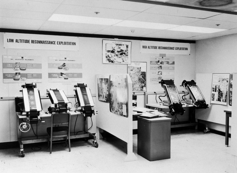 Inside the National Photographic Interpretation Center during the Cuban Missile Crisis. Here, photo interpreters pored over large-format negatives brought back by USAF U-2 and RF-101 reconnaissance aircraft for evidence of Russian missiles. (U.S. Air Force photo)