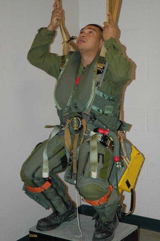 Senior Airman Luna checks his parachute lines during egress training.  (USAF photo/Senior Master Sgt. Marcus Falleaf)