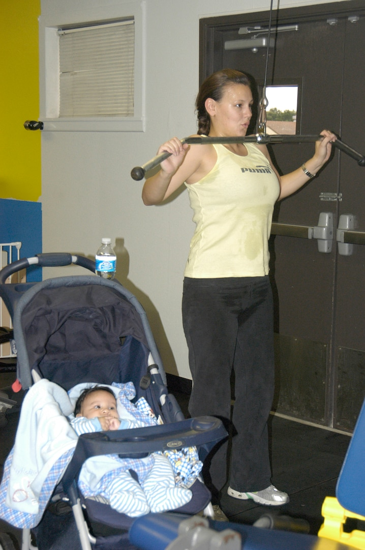 With the opening of the new family fitness room at the Warhawk Fitness Center on Lackland Air Force Base, Texas, Wendy Wong no longer has to decide between working out and staying home to watch the baby. Mrs. Wong is the wife of Staff Sgt. Danny Wong, 759th Medical Operations Squadron. (USAF photo by Mandi Cruz)