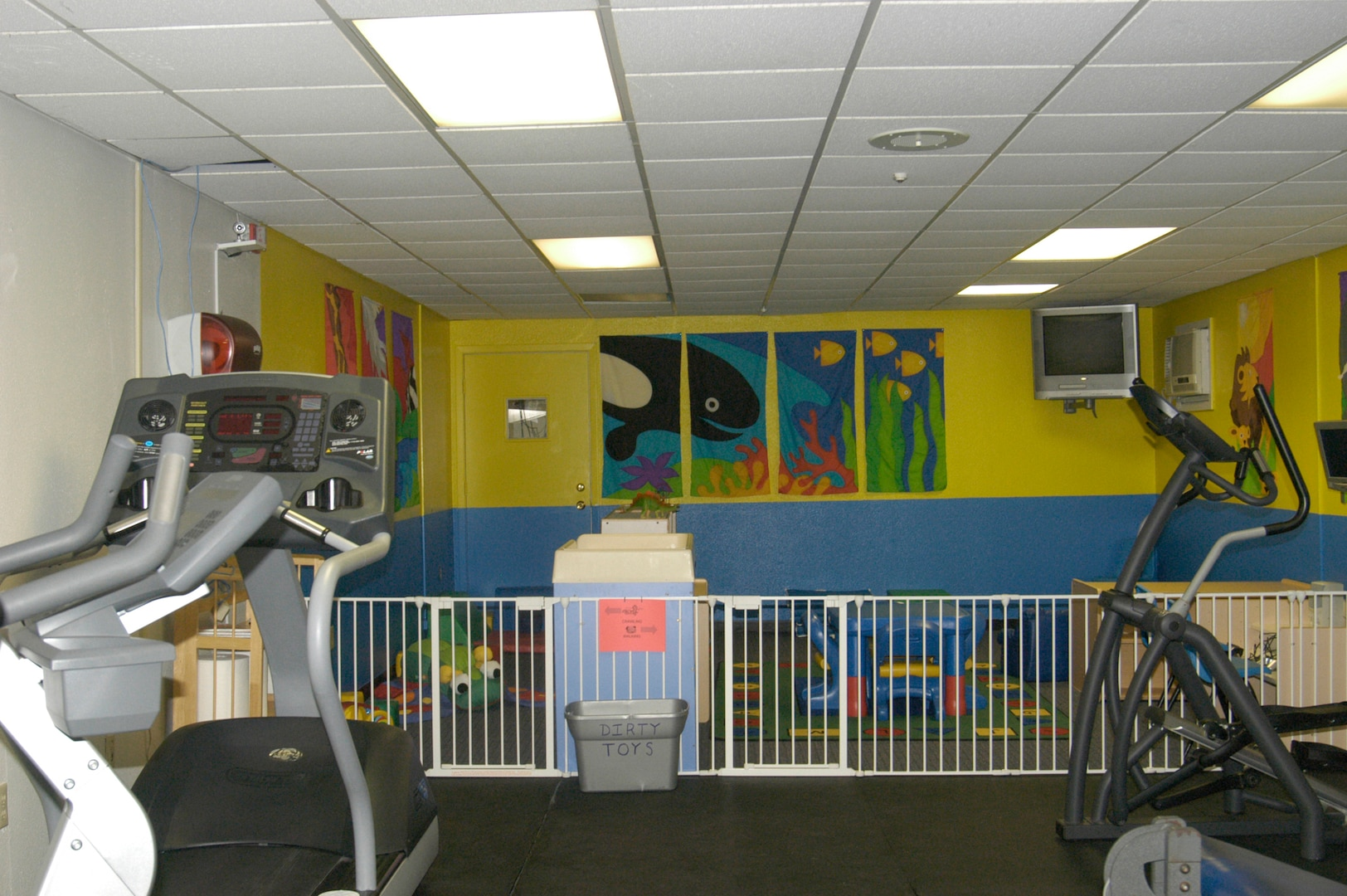 The new family fitness room at the Warhawk Fitness Center on Lackland Air Force Base, Texas, is designed to allow children to play while their parents or guardians exercise. (USAF photo by Mandi Cruz)