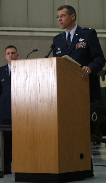 Col. Thomas Bussiere, 509th Operations Group commander, addresses the 509th OG during the OG change of command 9 July. (U.S. Air Force photo/Airman 1st Class Stephen Linch)