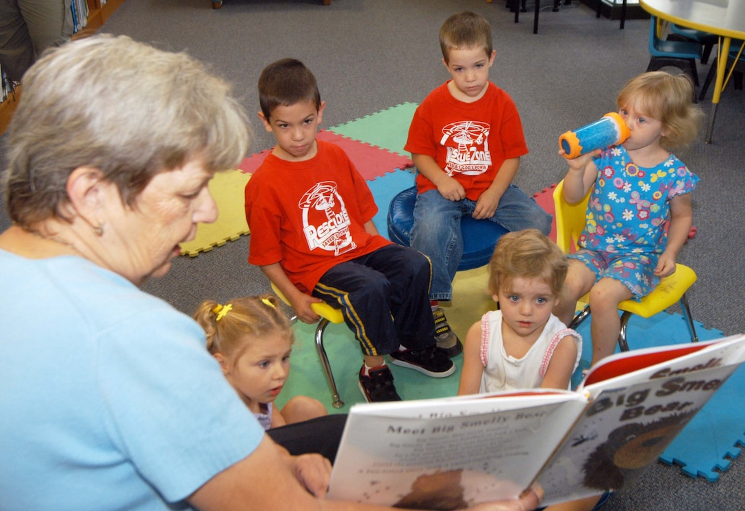 "Blanchella Casey, supervisory librarian, reads the book, ""Big Smelly Bear"" to preschool children at the library July 2. U. S. Air Force photo by Sue Sapp"