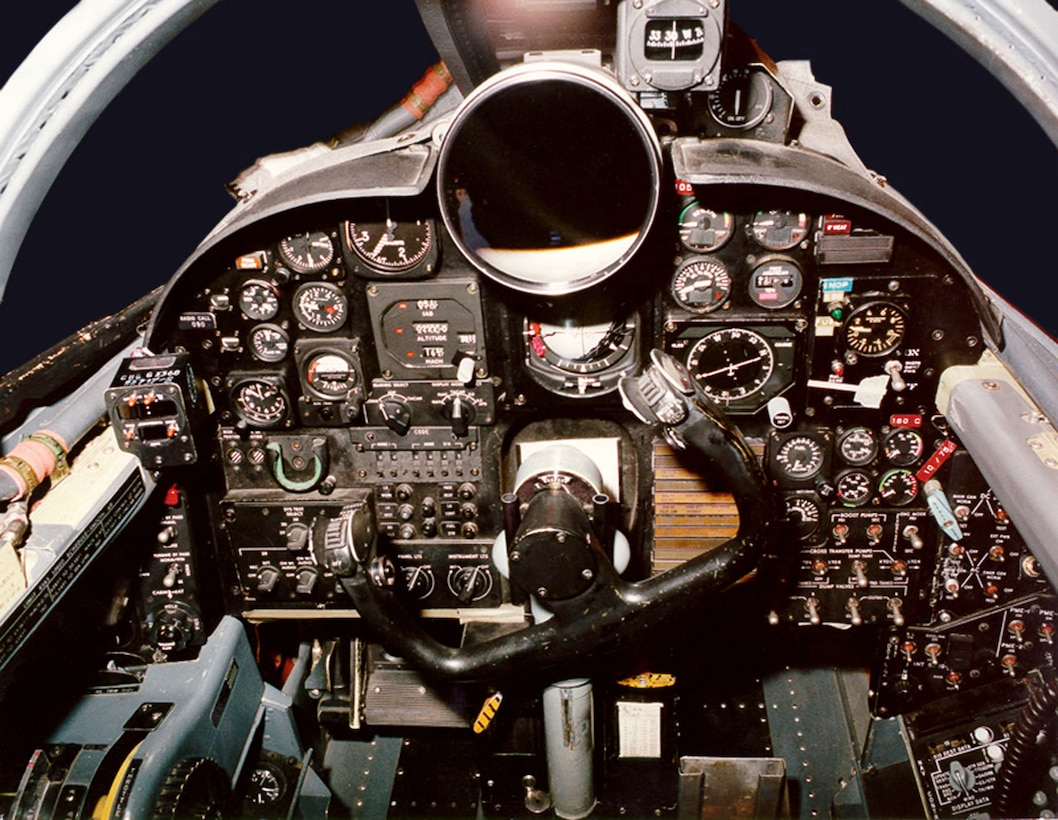 """The older U-2 cockpit used traditional dials and a large """"driftsight"""" telescope to help the pilot see the landscape below. (U.S. Air Force photo)"""