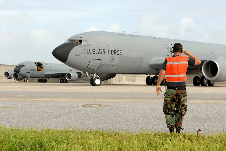 Senior Airman Shawn Denoma salutes as a KC-135 Stratotanker taxis for departure at Kadena Air Base, Japan, July 12, 2007, enroute to Anderson Air Force Base, Guam as part of the base's typhoon evacuation.  In preparation for Typhoon Man-Yi, the majority of KC-135 aircraft assigned to the base are being evacuated. Typhoon Man-Yi, the first typhoon of the year for Okinawa, is expected to make landfall Friday at Kadena. Airman Denoma is assigned to 718th Aircraft Maintenance Squadron. U.S. Air Force  photo/Airman 1st Class Kelly Timney