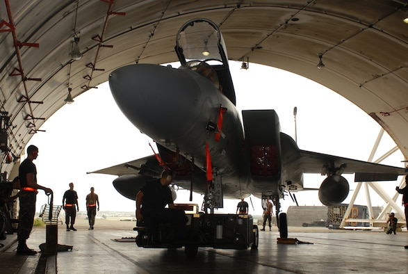 Airmen from the 18th Aircraft Maintenance Squadron tow an F-15C Eagle into a protective aircraft shelter on Kadena Air Base, Japan, July 12, 2007.  Some base aircraft  were moved into hangars and protective aircraft shelters to keep them safe from fast approaching Typhoon Man-Yi, the first for Okinawa this year.  It's expected to make landfall Friday at Kadena. Sergeant Farr is a crew chief with the 18 Aircraft Maintenance Squadron.  U.S. Air Force  photo/Airman 1st Class Kelly Timney