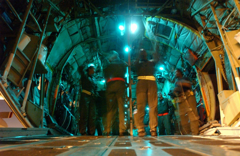 Members of the 18th Aeromedical Evacuation Squadron , Kadena Air Base, Japan, simulate evacuating casualties from a C-130 Hercules at Marine Corps Air Station Futenma, Japan, in preparation for Air Mobility Rodeo  2007. The unit practiced in the evenings to simulate night time operations for wartime missions. U.S. Air Force photo/Staff Sgt. Reynaldo Ramon