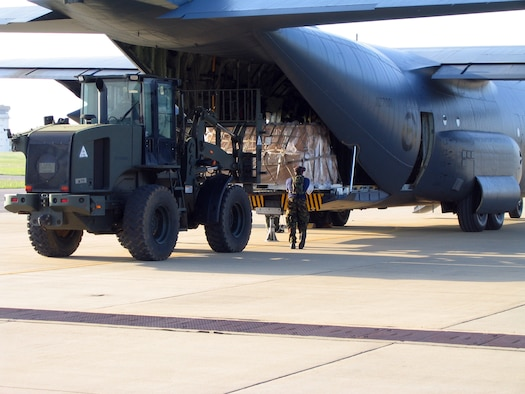 An Airman with the New Zealand Air Force uploads pallets onto a C-130 with the help of 452nd Air Mobility Wing Airmen from March Air Reserve Base. Five members from the 452nd Tanker Airlift Control Element at March ARB went to Fort Polk, La., to participate in a Joint Readiness Training Exercise last month. They spent ten days training with two air movement crews from the New Zealand Air Force who were participating in simulated desert combat training scenarios. With the use of a C-130 from New Zealand's Hercules aircraft fleet, the reservists from March helped train their international counterparts through various exercises to include day and night air drops