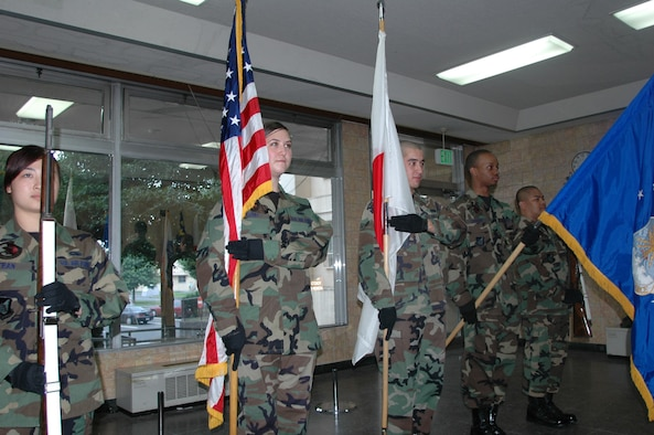 Yokota Air Base Honor Guard members train on presentation of the colors June 29 in Tower 2000. Honor Guard is a tradition and detial that is held highly in the U.S. Air Force. (U.S. Air Force photo by Airman 1st Class Eric Summers)