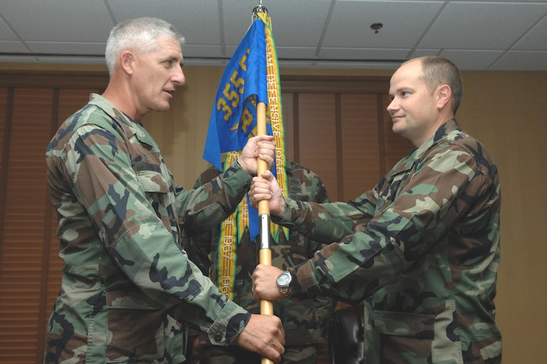 Maj. David A. Paynter (right) receives the 355th Logistics Readiness Squadron guidon from 355th Mission Support Group Commander Col. Hal V. Hoxie during a change-of-command ceremony at the Mirage Officer's Club here July 12. Major Paynter was previously the chief of deployment policy and guidance for Headquarters Air Combat Command at Langley Air Force Base, Va. (U.S. Air  Force photo/Airman First Class Noah R. Johnson)